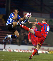 Photo: Matt Bright/Sportsbeat Images.<br /> Crystal Palace v Sheffield Wednesday. Coca Cola Championship. 15/12/2007.<br /> Wade Small of Sheffield Wednesday wins an arial challange with  Clint Hill of Crystal Palace