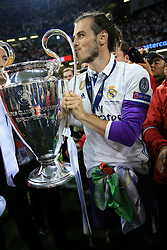3rd June 2017 - UEFA Champions League Final - Juventus v Real Madrid - Gareth Bale of Real kisses the trophy - Photo: Simon Stacpoole / Offside.