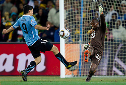 Luis Suarez of Uruguay vs Goalkeeper of Ghana Richard Kingson during the  2010 FIFA World Cup South Africa Quarter Finals football match between Uruguay and Ghana on July 02, 2010 at Soccer City Stadium in Sowetto, suburb of Johannesburg. Uruguay defeated Ghana after penalty shots. (Photo by Vid Ponikvar / Sportida)