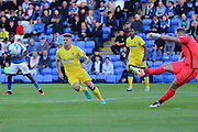 AFC Wimbledon midfielder Jake Reeves (8) and Peterborough United goalkeeper Ben Alnwick (1) during the EFL Cup match between Peterborough United and AFC Wimbledon at ABAX Stadium, Peterborough, England on 9 August 2016. Photo by Stuart Butcher.