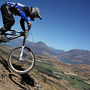 Rupert Chapman from Christchurch in action during the NZBNZ South Island Downhill Cup mountain bike downhill series held on The Remarkables face with a stunning backdrop of the Wakatipu Basin. 150 riders took part in the two day event.  Queenstown, Otago, New Zealand. 9th January 2012. Photo Tim Clayton