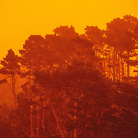 Smoke from California wildfires paints the sky orange and darkens the day in Montara, California on September 9, 2020.