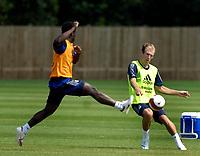Photo: Daniel Hambury.<br />Chelsea Training Session. The Barclays Premiership. 24/07/2006.<br />Arjen Robben flicks the ball past Michael Essien during training.