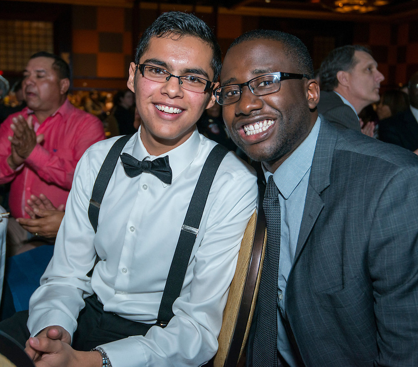 Former EMERGE student and Stanford freshman Felipe Guillen, left, poses for a photograph with mentor August Hamilton during the State of the Schools luncheon, February 11, 2015.