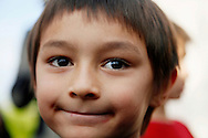Six-year-old Falcon Heene smiles as he is surrounded by reporters on the lawn of his house in Fort Collins, Colorado October 15, 2009. Heene, who set off a massive search and rescue operation and media frenzy after it was reported he was inside a homemade helium balloon that broke loose and drifted for hours thousands of feet above Colorado has been found safe in his attic, police said on Thursday. .REUTERS/Rick Wilking (UNITED STATES SOCIETY IMAGES OF THE DAY)