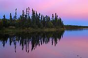 Boreal forest reflected in Cockeram Lake at duck<br />Near Lynn Lake<br />Manitoba<br />Canada