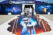 BEIJING, CHINA - AUGUST 06: (CHINA OUT) <br /> <br /> 3D Painting Show<br /> <br /> People pose with a 3D painting during a 3D painting show at China Television Tower on August 6, 2014 in Beijing, China. There are more than 230 3D paintings on display.<br /> ©Exclusivepix