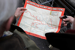 © Licensed to London News Pictures. 13/01/2013, London, UK. Two men look at an early Metropolitan Railway map as they wait at Barbican underground station in London for the arrival of the newly restored Met Locomotive No. 1 steam train, Sunday, Jan. 13, 2013, to mark the 150th anniversary of the opening of the world's first underground in January 1863. Linked to the Met Locomotive No 1 engine was the oldest surviving operational underground carriage, the Metropolitan Railway Jubilee Carriage 353, a set of four Chesham carriages and the world's oldest electric locomotives in service, No 12 Sarah Siddons. Photo credit : Sang Tan/LNP