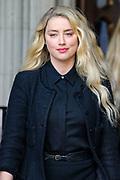 "American actress and model Amber Heard gives a statement in front of the Royal Courts of Justice in central London on Tuesday, July 28, 2020.<br /> An article in the Sun describing Johnny Depp as a ""wife-beater"" was ""one-sided"" and ""not researched at all"", the actor's lawyer told the High Court. In closing submissions for Mr Depp, David Sherborne said the paper acted as ""both judge and jury"". Mr Depp is suing the newspaper's publisher and editor for libel, saying the allegation is ""completely untrue"". (VXP Stringer)"