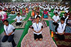 June 21, 2017 - Allahabad, Uttar Pradesh, India - People performing Yoga on the occasion of 3rd International Yoga Day celebration at Parade Ground during rain in Allahabad.  (Credit Image: © Prabhat Kumar Verma via ZUMA Wire)