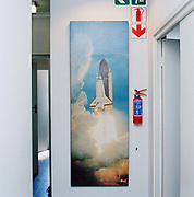 Decor dating back to opening of the office, Cape Town.  Most of the office staff have been here  for over twenty years. From the series Desk Job a project which explores globalisation through office life around the World.