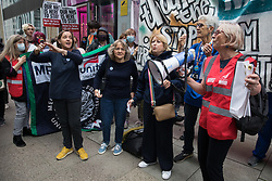 London, UK. 5th July, 2021. The National Health Supporters Choir performs with health workers and supporters at a rally organised by Doctors in Unite outside the Department of Health and Social Care. The rally was organised to mark the 73rd birthday of the National Health Service and in protest against the sale of one of the UK's biggest GP practice operators to the US health insurance group Centene Corporation.