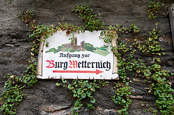 Sign towards castle in Beilstein village on River Mosel in Rhineland-Palatinate Germany