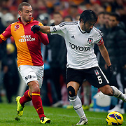 Galatasaray's Wesley Sneijder (L) during their Turkish superleague soccer derby match Galatasaray between Besiktas at the TT Arena at Seyrantepe in Istanbul Turkey on Sunday, 27 January 2013. Photo by Aykut AKICI/TURKPIX