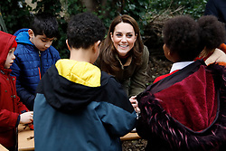 The Duchess of Cambridge helps make winter bird feed during a visit to the King Henry's Walk Garden in Islington, London to learn about a project bringing people together through a shared love of horticulture.