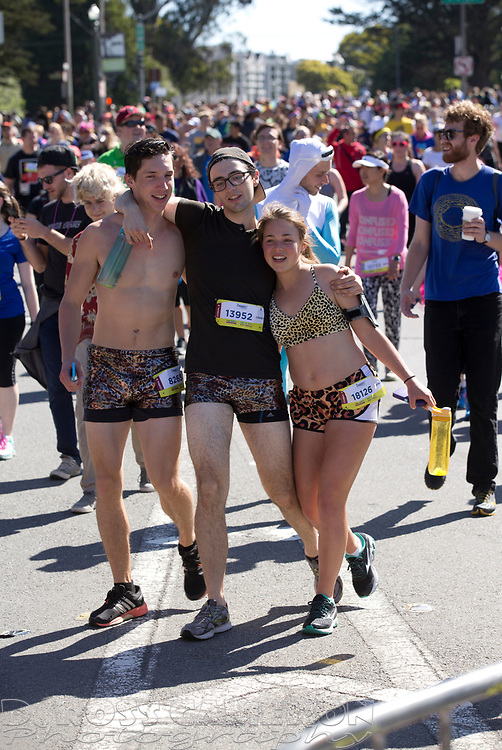 Though alcohol has been banned from the race, there is a distinct feeling of inebriation between three friends supporting each other through Golden Gate Park, during the 105th running of the Bay to Breakers 12k, Sunday, May 15, 2016 in San Francisco. The 7.42-mile race from San Francisco Bay to the Pacific Ocean, attracts a field of tens of thousands of runners, from the elite to the weekend warrior, some clad in costume and some in nothing at all. (Photo by D. Ross Cameron)