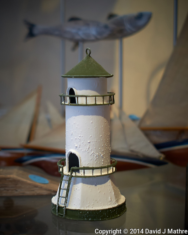 Flying Fish Above a Lighthouse Replica. National Maritime Museum, Dublin, Ireland. Semester at Sea, Summer 2014 Voyage. Image taken with a Leica X2 camera (ISO 200, 24 mm, f/2.8, 1/50 sec). Raw image processed with Capture One Pro, Focus Magic, and Photoshop CC 2014.