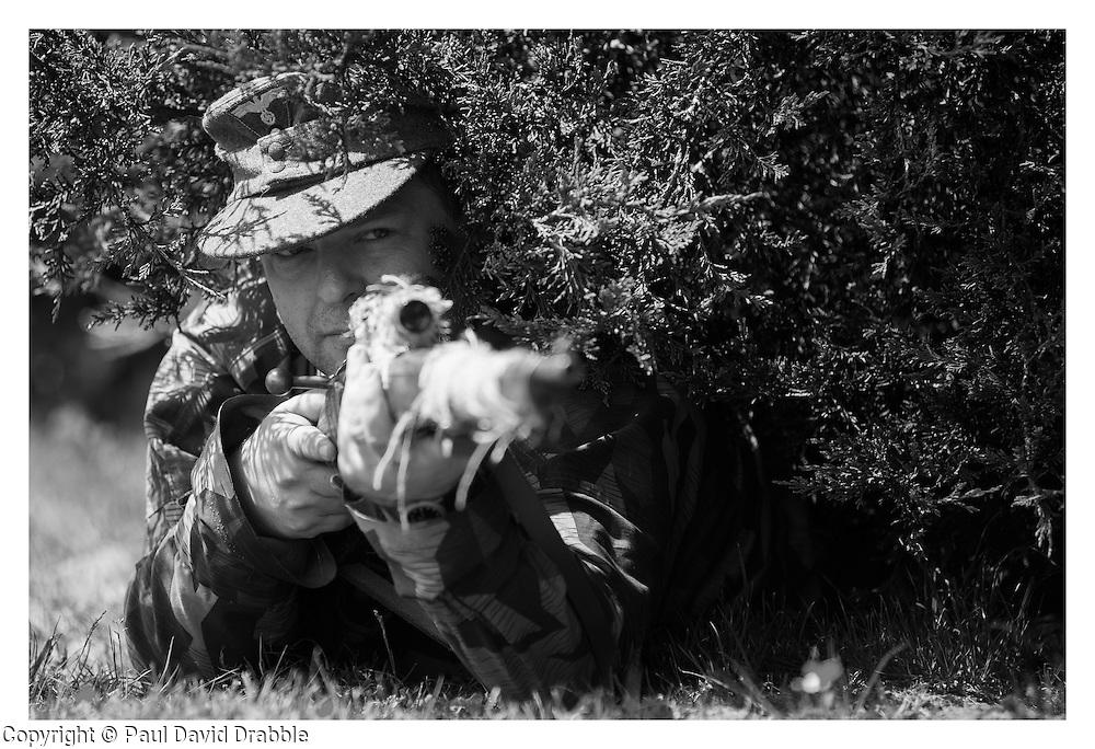 "1./ Kompanie Gro§deutschland's newest recruit makes his debute appearance at the Northallerton Wartime Weekend portraying a ""ScharfschŸtzen"" or Sniper <br /> <br /> 16 June 2013<br /> Image © Paul David Drabble<br /> www.pauldaviddrabble.co.uk"