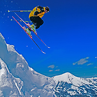A skier jumps a cornice at exclusive Yellowstone Club Ski Area, Montana.