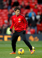 Shinji Kagawa of Manchester United warms up before the Barclays premiership match, Manchester united v West Ham,  Old Trafford, Manchester, UK