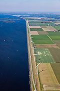 Nederland, Flevoland, Gemeente Zeewolde, 06-09-2010; Eemmeer met windmolens aan de Eemmeerdijk, gezien naar Almere..Eemmeer with windmills on the dike of polder Flevoland..luchtfoto (toeslag), aerial photo (additional fee required).foto/photo Siebe Swar