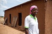 Abdulai Sadia stands outside the building where she teaches children in the community of Kunayili, near Gushegu, Northern Ghana, on Wednesday November 2, 2011.