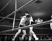 Nash vs Leon Championship Fight.    (N55)..1980..14.12.1980..12.14.1980..14th December 1980..At the Burlington Hotel, Dublin, Charlie Nash defended his European Lightweight Title when he took on Spain's Francesco Leon. .Picture shows Nash ducking under Leon's left as he throws body punches.