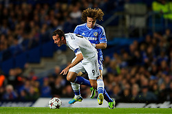 Basel Forward Marco Streller (SUI) is challenged by Chelsea Defender David Luiz (BRA) during the first half of the match - Photo mandatory by-line: Rogan Thomson/JMP - Tel: 07966 386802 - 18/09/2013 - SPORT - FOOTBALL - Stamford Bridge, London - Chelsea v FC Basel - UEFA Champions League Group E