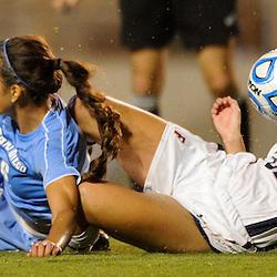 San Diego senior defender Natalie Garcia slide tackles Cal State Fullerton junior defender Kellie Bohner (21) during Fullerton's 2-0 victory on Sept. 22, 2011 at Titan Stadium.