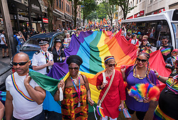 © Licensed to London News Pictures.  14/07/2018; Bristol, UK. Bristol Pride 2018; parade through Bristol with the rainbow flag in celebration for all sections of the LGBT community. Picture of start of parade with from left: MARVIN REES elected mayor of Bristol, Councillor ASHER CRAIG Deputy Mayor with responsibility for Communities, Events and Equalities, Police and Crime Commissioner (PCC) for Avon and Somerset SUE MOUNTSTEVENS, CLEO LAKE Bristol Lord Mayor. Photo credit: Simon Chapman/LNP