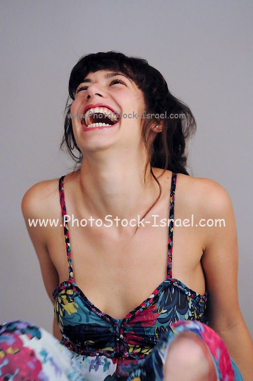 Happy excited young female model in her 20s Model Release available