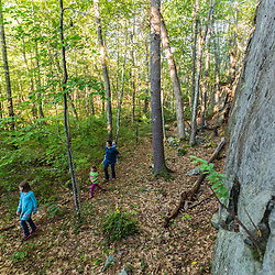A woman and her kids hike a forest trail at the Kenyon Hill preserve in South Berwick, Maine.