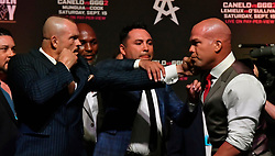 9-14-18. Las Vegas NV.(C) Golden Boys  Oscar De La Hoya tries to keep the pease between(L-R), Chuck Liddell and Tito Ortiz during the GGG vs Canelo weight in in Las Vegas Friday. The two will fight for a 3rd time in Los Angeles at the Forum in Inglewood on Nov 24th, and will be presented live on Pay-Per-View beginning at 6:00 p.m. PT/9:00 p.m. ET.. Photo by Gene Blevins/LA DailyNews/ZumaPress (Credit Image: © Gene Blevins/ZUMA Wire)