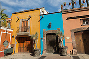 Spanish colonial style homes in pastel colors on Recreo Street in the historic center in San Miguel de Allende, Mexico.