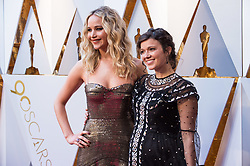 March 4, 2018 - Hollywood, California, U.S. - JENNIFER LAWRENCE and guest arrive on the red carpet of The 90th Oscars at the Dolby Theatre in Hollywood. (Credit Image: © Phil McCarten/AMPAS via ZUMA Wire/ZUMAPRESS.com)