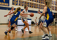 Franklin's Riley Haskins puts pressure on Gilford's Olivia Harris during NHIAA Division III basketball Tuesday evening.  (Karen Bobotas/for the Laconia Daily Sun)