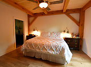 The master bedroom at the home of Steve and Jennifer Schatz of rural Pacific. The open-concept home is designed to resemble a Missouri dairy barn with exposed timbers throughout the interior.<br /> Photo by Tim Vizer
