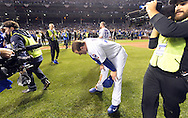 CHICAGO, IL - OCTOBER 22: Anthony Rizzo pauses for a moment during the post game celebration on the field after the Cubs defeated the Los Angeles Dodgers in Game 6 of the NLCS at Wrigley Field on Saturday, October 22, 2016 in Chicago, Illinois. (Photo by Ron Vesely/MLB Photos via Getty Images)