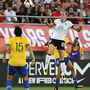 U.S. defender Leigh Ann Robinson (26) heads the ball during a women's soccer International friendly match between Brazil and the United States National Team, at the Florida Citrus Bowl  on Sunday, November 10, 2013 in Orlando, Florida. The U.S won the game by a score of 4-1.  (AP Photo/Alex Menendez)