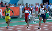 From left: Michael Frater of Jamica (729), Darrel Brown of Trinidad and Tobago (1331) and Darren Campbell of Great Britain (513) in the IAAF World Championships in Athletics at Stade de France on Sunday, Aug, 24, 2003.