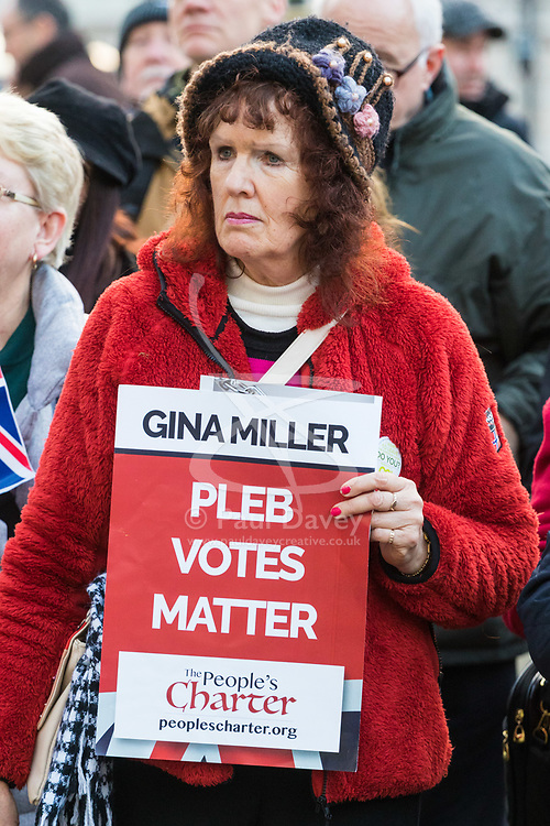 PLACE, January 14 2018. A few dozen protesters from 'The People's Charter' group demonstrate outside Downing Street demanding that the Brexit referendum result is respected following calls for a second referendum. PICTURED: A woman's placard appears to rail against Gina Miller's court challenge against the British government over its authority to implement Brexit without approval from Parliament. © Paul Davey