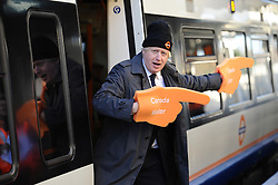 © Licensed to London News Pictures. 10/12/20112. London, United Kingdom. London Mayor Boris Johnson opens the London overground Southern extension creating the capitals first orbital surface railway. The new link between Clapham Junction and Surray Quays means passengers can avoid changing in central London. Photo credit : Justin Setterfield/LNP