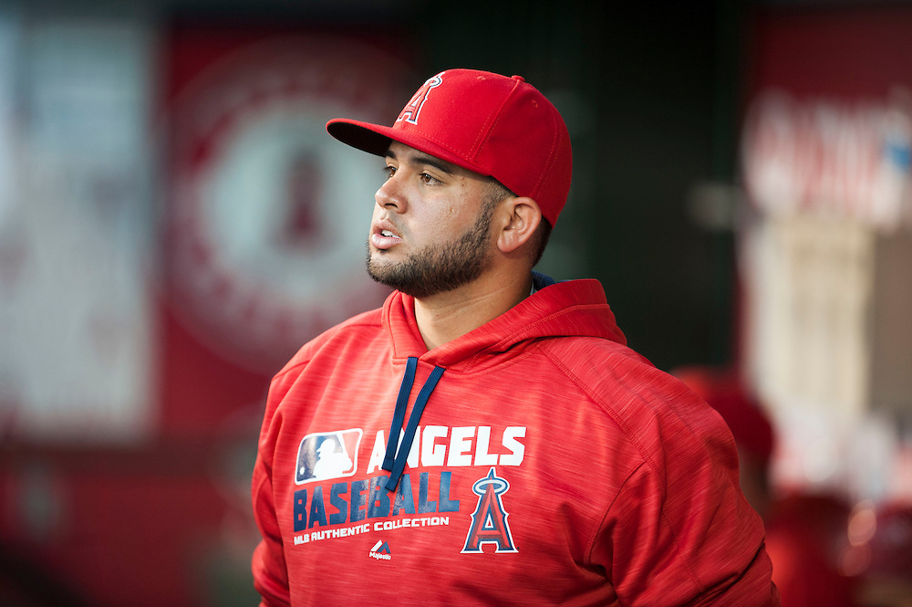 The Angels' Juan Graterol walks in the dugout after being called up against the Texas Rangers at Angel Stadium on Tuesday.<br /> <br /> ///ADDITIONAL INFO:   <br /> <br /> angels.0720.kjs  ---  Photo by KEVIN SULLIVAN / Orange County Register  -- 7/19/16<br /> <br /> The Los Angeles Angels take on the Texas Rangers at Angel Stadium.