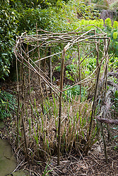 Woven hazel support for miscanthus in the Oast garden