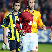 Galatasaray's Lucas NEILL (F) and Fenerbahce's Mehmet TOPUZ (B) during their Turkish superleague soccer derby match Galatasaray between Fenerbahce at the AliSamiYen Stadium at Mecidiyekoy in Istanbul Turkey on Sunday, 28 March 2010. Photo by TURKPIX