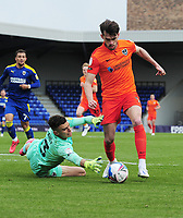 Football - 2020 /2021 Sky Bet League One - AFC Wimbledon vs Portsmouth - Plough Lane<br /> <br /> John Marquis of Portsmouth goes round goalkeeper, Nik Tzanev of Wimbledon