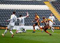 Hull City's Keane Lewis-Potter scores his side's second goal in the 71st minute to make it 2-0 despite the attentions of Oxford United's Elliott Moore<br /> <br /> Photographer Lee Parker/CameraSport<br /> <br /> The EFL Sky Bet League One - Hull City v Oxford United - Saturday 13th March 2021 - KCOM Stadium - Kingston upon Hull<br /> <br /> World Copyright © 2021 CameraSport. All rights reserved. 43 Linden Ave. Countesthorpe. Leicester. England. LE8 5PG - Tel: +44 (0) 116 277 4147 - admin@camerasport.com - www.camerasport.com