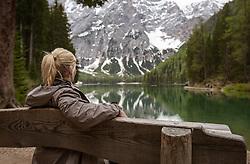THEMENBILD - eine Frau sitzt auf einer Bank am Ufer des Pragser Wildsee, aufgenommen am 11. Mai 2018, Prags, Österreich // A woman is sitting on a bench on the shore of the Pragser Wildsee on 2018/05/11, Prags, Austria. EXPA Pictures © 2018, PhotoCredit: EXPA/ Stefanie Oberhauser