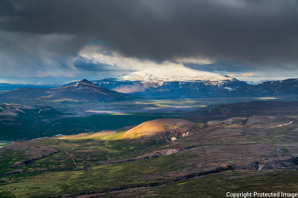 A view of the uplands of west Iceland, with <br /> the glacier Eiríksjökull in the background