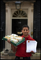 Jitin Dixit from London  joins subway owner David Cameron to deliver a petition to Downing Street from Subway, Tuesday January 22, 2013. Photo: Andrew Parsons / i-Images